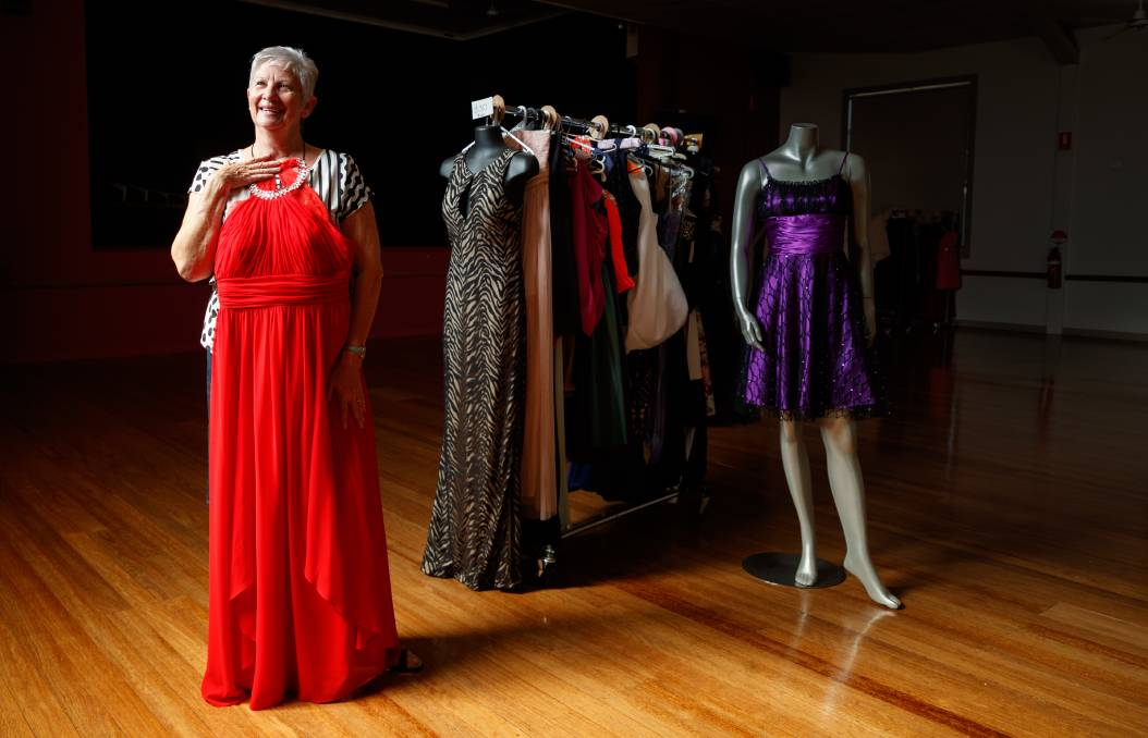 BEAUTIFUL BARGAINS: Pop-up formal wear shop organiser Helen Scott, with some of the dresses that will be available for sale at Branxton Community Hall this Saturday. Picture: Max Mason-Hubers