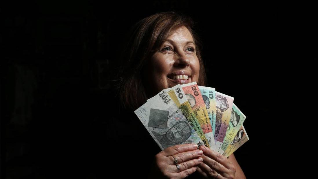 CASHED UP: Sue Jarrett from Campbell's Store, Morpeth with some of the old bank notes that will be on display this weekend. PICTURE: Simone De Peak.