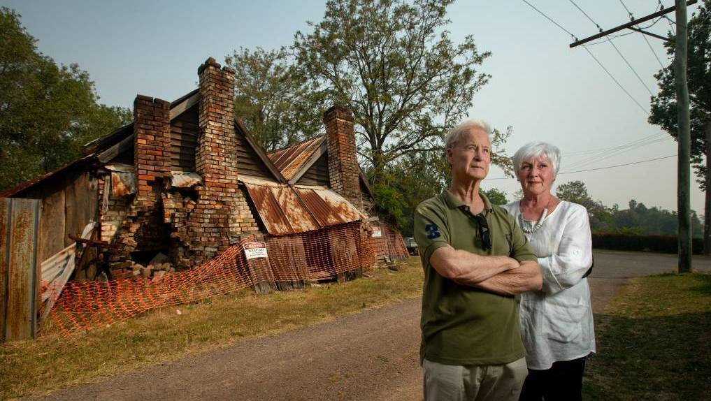 HISTORIC: Chris Richards and Elisabeth Smark, from the neighbouring School of Arts, in front of Pomfrett's Cottage, which will now be demolished. Picture: Marina Neil.