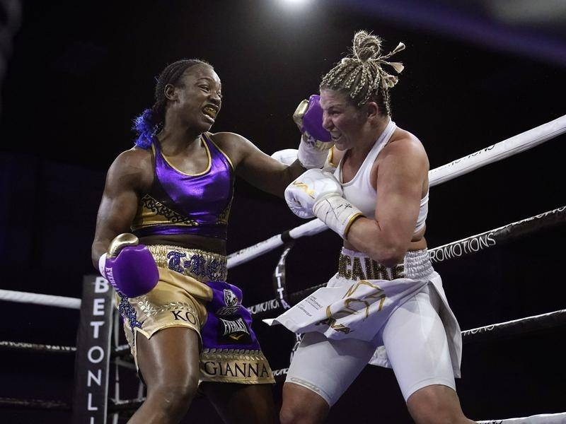 Claressa Shields (l) made boxing history when she beat Marie-Eve Dicaire (r) in Flint, Michigan.