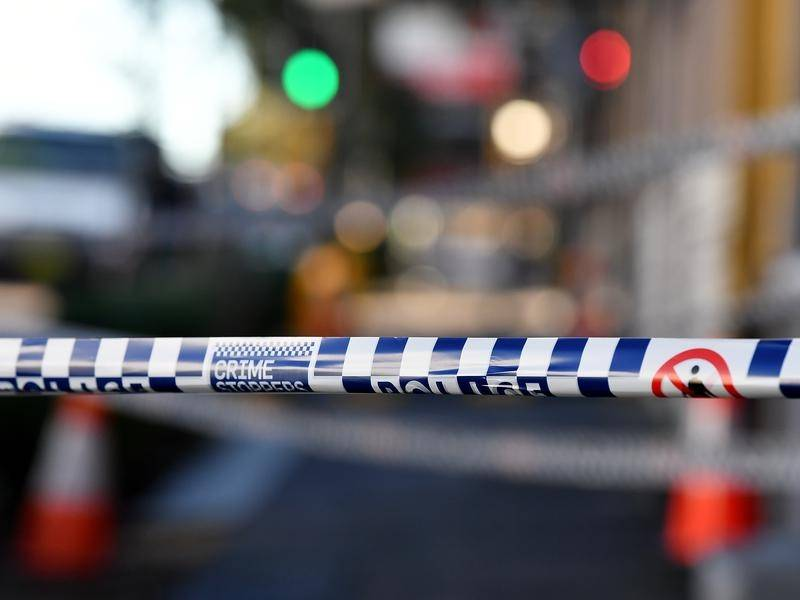 A woman has been fatally struck by a garbage truck in Sydney's southwest.