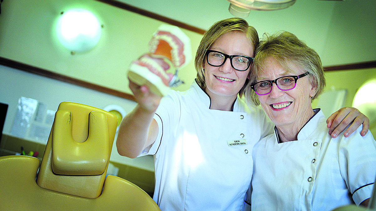 in mum's footsteps:  Genevieve and Louise Nawrot, who work as dentists in Maitland.  	Picture by CATH BOWEN